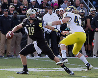 Michigan Wolverine linebacker Jack Ryan sacks Purdue Boilermaker quarterback Caleb TerBush. The Michigan Wolverines defeated the Purdue Boilermakers 44-13 on October 6, 2012 at Ross-Ade Stadium in West Lafayette, Indiana.