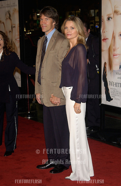 Actress MICHELLE PFEIFFER & husband DAVID E. KELLEY at the Los Angeles premiere of her new movie White Oleander..08OCT2002.  © Paul Smith / Featureflash