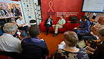 Michel Sidibé, the executive director of UNAIDS, speaks on July 24 with religious leaders and activists at the 2018 International AIDS Conference in Amsterdam, Netherlands. On the right is Father Richard Bauer, a Maryknoll priest from the United States who works with HIV positive people in Kenya. The meeting took place in the Interfaith Networking Zone, a space sponsored by the World Council of Churches-Ecumenical Advocacy Alliance in the conference's Global Village.