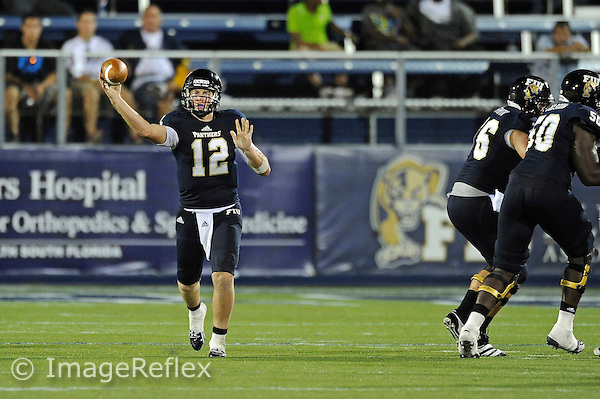 8 September 2012:  FIU quarterback Jake Medlock (12) passes in the fourth quarter as the FIU Golden Panthers defeated the Akron Zips, 41-38 (overtime), at FIU Stadium in Miami, Florida.