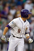 LSU Tiger first baseman Mason Katz (8) watches his fourth inning home-run in Game 4 of the 2013 Men's College World Series against the UCLA Bruins on June 16, 2013 at TD Ameritrade Park in Omaha, Nebraska. UCLA defeated LSU 2-1. (Andrew Woolley/Four Seam Images)
