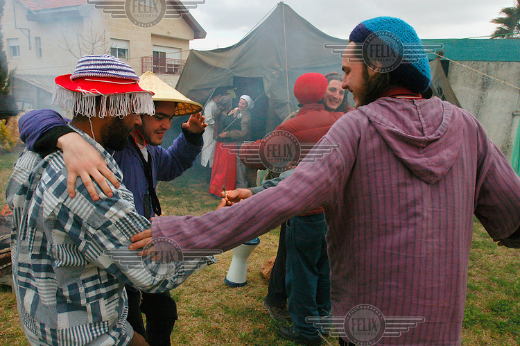 Jewish settlers share a joint during a Purim holiday party in the Jewish settlement of Elazar.