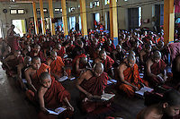 """Monks recite prayers in a monastery, Mandalay, Burma November 08.  Monks in this largely Buddhist country have to beg from villagers in order to feed themselves and in this city the government hand-outs stopped after the """"saffron revolution"""" of October 2007.<br /> <br /> Photo by Richard Jones"""