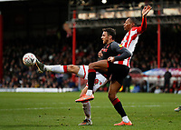 4th January 2020; Griffin Park, London, England; English FA Cup Football, Brentford FC versus Stoke City; Lee Gregory of Stoke City being challenged by Ethan Pinnock of Brentford - Strictly Editorial Use Only. No use with unauthorized audio, video, data, fixture lists, club/league logos or 'live' services. Online in-match use limited to 120 images, no video emulation. No use in betting, games or single club/league/player publications