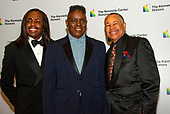 The band Earth, Wind & Fire, from left to right, bassist Verdine White, singer Philip Bailey, and percussionist Ralph Johnson arrive for the formal Artist's Dinner honoring the recipients of the 42nd Annual Kennedy Center Honors at the United States Department of State in Washington, D.C. on Saturday, December 7, 2019. The 2019 honorees are: Earth, Wind & Fire, Sally Field, Linda Ronstadt, Sesame Street, and Michael Tilson Thomas.<br /> Credit: Ron Sachs / Pool via CNP