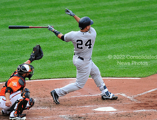 New York Yankees catcher Gary Sanchez (24) swings the bat in the top of the fifth inning against the Baltimore Orioles at Oriole Park at Camden Yards in Baltimore, MD on Saturday, April 8, 2017.  Sanchez was injured on the play. The Orioles won the game 5 - 4.<br /> Credit: Ron Sachs / CNP<br /> (RESTRICTION: NO New York or New Jersey Newspapers or newspapers within a 75 mile radius of New York City)
