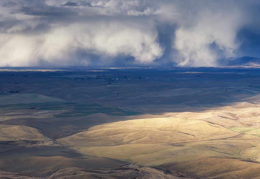 Huge storm clouds give the sense of danger as seen from the hillside of Steptoe Butte in Eastern Washington State.