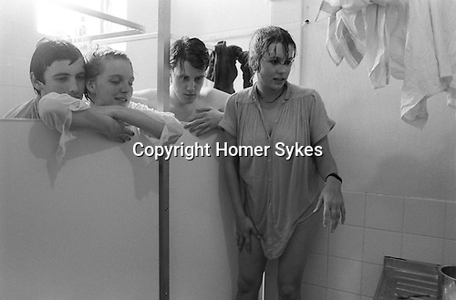A group of students undergraduates at Corpus Christi college take a shower  together at Cambridge University  England. 1983