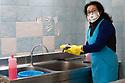 19 marzo 2020, Sassari, via Amendola. Pescheria Pintus. Caterina Pintus prepara un pesce per un cliente.