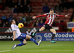 Billy Sharp of Sheffield United crosses the ball past Craig Jones of Bury during the English Football League One match at Bramall Lane, Sheffield. Picture date: November 22nd, 2016. Pic Jamie Tyerman/Sportimage