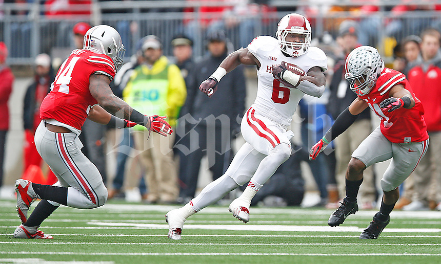 Indiana Hoosiers running back Tevin Coleman (6) gets past Ohio State Buckeyes linebacker Curtis Grant (14) and Ohio State Buckeyes defensive back Vonn Bell (11) for yardage in the first half at Ohio Stadium on 22, 2014. (Chris Russell/Dispatch Photo)