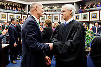 TALLAHASSEE, FLA. 3/4/14-Gov. Rick Scott, left, greets Florida Supreme Court Chief Justice Ricky Polston, right, during the opening day of the legislative session, March 4, 2014 at the Capitol in Tallahassee.<br /> <br /> COLIN HACKLEY PHOTO