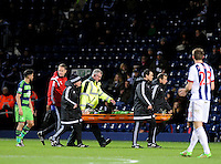 Ki Sung-Yueng of Swansea City is taken off on a stretcher during the Barclays Premier League match between West Bromwich Albion and Swansea City at The Hawthorns on the 2nd of February 2016