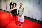 Utrecht, 22 september 2010.Nederlands Film Festival.Openingsavond met premiere Tirza..Actrice Keitumetse Matlabo (9 jaar) op de rode loper. Een medewerkster van de filmproducent wijst haar waar ze moet kijken...Foto Felix Kalkman