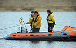 27-01-12:  Ballinskelligs Rescue team members taking part in the search for Neilus O'Connor at the White Sand Lake, Cromane, Co. Kerry on Friday. Mr O'Connor was missing after going out on a kayak on the lake in the early hours of Friday morning.   Picture: Eamonn Keogh (MacMonagle, Killarney)