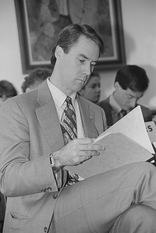 Party member holding file in office, in March 1994. (Photo by Maureen Keating/CQ Roll Call via Getty Images)