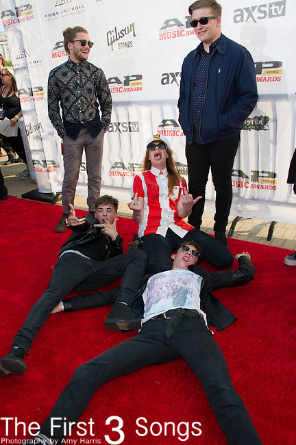 Becca Macintyre, Sam Macintyre, Jack Bottomley, Will Bottomley, and Josh Macintyre of Marmozets attend the 2014 AP Music Awards at the Rock And Roll Hall Of Fame and Museum at North Coast Harbor in Cleveland, Ohio.