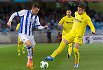 Real Sociedad's Haris Seferovic (l) and Villareal's Gabriel Armando de Abreu during Copa del Rey match.November 23,2013. (ALTERPHOTOS/Mikel)