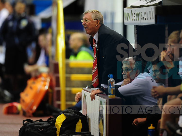 Sir Alex Ferguson watches team struggle from the dug out