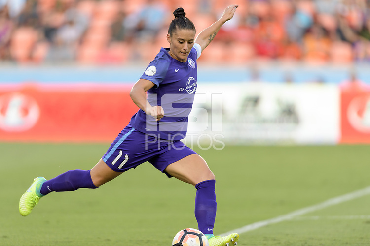 Houston, TX - Saturday June 17, 2017: Ali Krieger clears the ball from her side of the field during a regular season National Women's Soccer League (NWSL) match between the Houston Dash and the Orlando Pride at BBVA Compass Stadium.