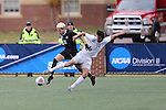 SALEM, VA - DECEMBER 3:Isky Van Doorne (26) of Calvin College and Nathan Majumder (24) of Tufts University battle for the ball during theDivision III Men's Soccer Championship held at Kerr Stadium on December 3, 2016 in Salem, Virginia. Tufts defeated Calvin 1-0 for the national title. (Photo by Kelsey Grant/NCAA Photos)