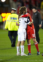 28 September 2010: Real Salt Lake midfielder Kyle Beckerman #5 and Toronto FC forward Mista #10 embrace at the conclusion of a CONCACAF Champions League game between Real Salt Lake and Toronto FC at BMO Field in Toronto..Final score was 1-1...