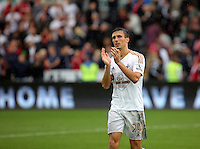 Pictured: Jack Cork of Swansea thanks home supporters after the end of the game Sunday 30 August 2015<br /> Re: Premier League, Swansea v Manchester United at the Liberty Stadium, Swansea, UK