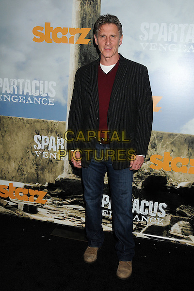 "Chris Stanley.""Spartacus: Vengeance"" Premiere Screening held at Arclight Cinemas, Hollywood, California, USA..January 18th, 2012.full length black maroon burgundy suit jacket jeans denim.CAP/ADM/BP.©Byron Purvis/AdMedia/Capital Pictures."
