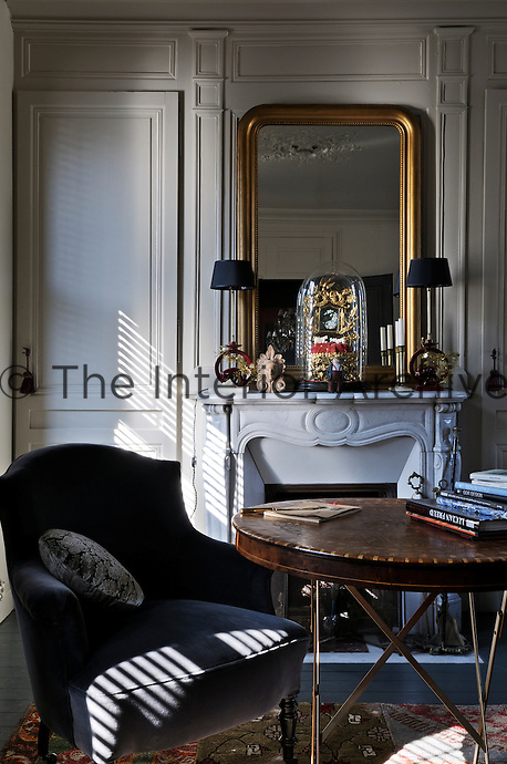 The living room reflects an important transformation which took place at the end of the 19th century and is classically French
