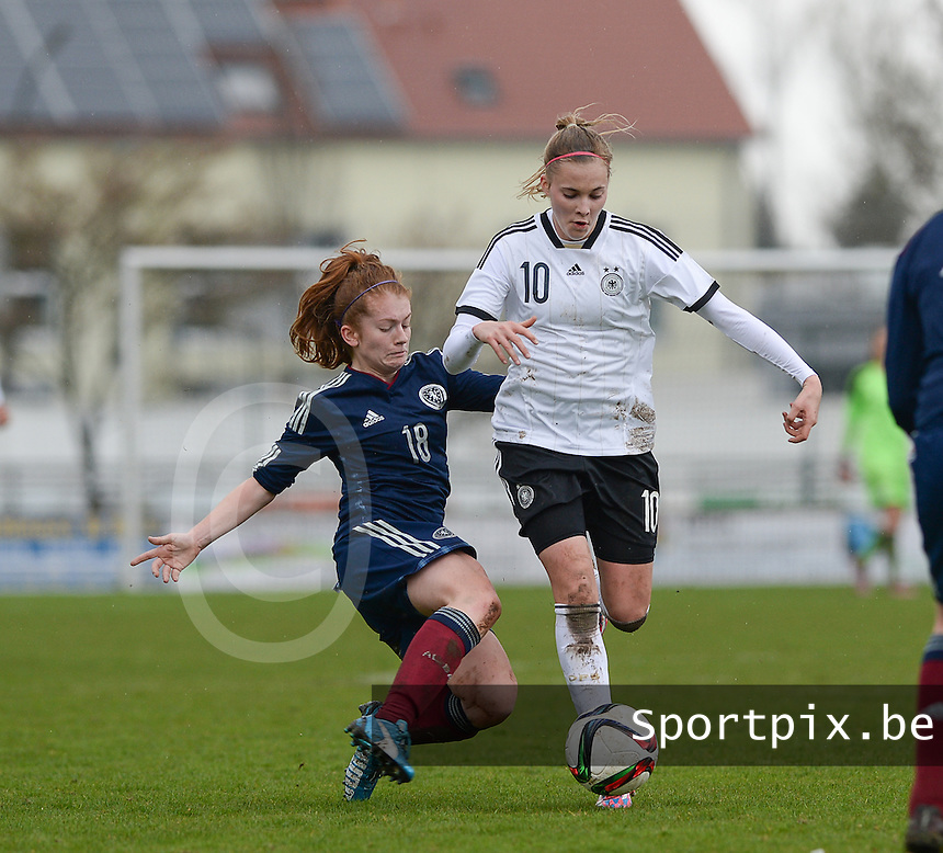 20150404 - FORST , GERMANY  : German Laura Freigang pictured being tackled by Scottish Megan Karagiozis (left) during the soccer match between Women Under 19 teams of Germany and Scotland , on the first matchday in group 5 of the UEFA Elite Round Women Under 19 at WaldseeStadion , Forst , Germany . Saturday 4th April 2015 . PHOTO DAVID CATRY