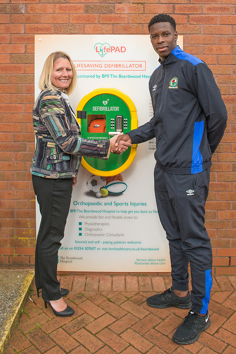 Samantha Sheehan, Executive Director of BMI Healthcare's Beardwood Hospital (left) at a ceremony with Blackburn Rovers FC player Lucas João marking the sponsorship of a Defibrillator unit by BMI Healthcare at Ewood Park, home of Blackburn Rovers FC.