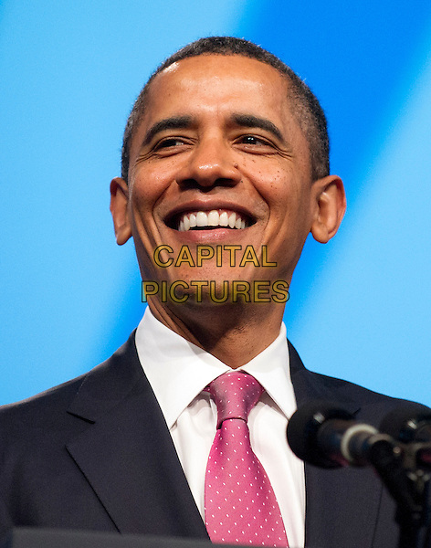 United States President Barack Obama smiles as he soaks in the applause prior to delivering remarks at the American Israel Public Affairs Committee (AIPAC) Policy Conference in Washington, D.C. on Sunday, March 4, 2012..headshot portrait black suit jacket pink smiling CAP/ADM/CNP/RS.©Ron Sachs/CNP/AdMedia/Capital Pictures.