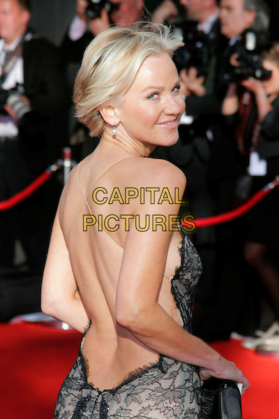 LISA MAXWELL.Arrivals at the British Academy Television Awards 2009, Royal Festival Hall, London, England. .April 26th 2009 .TV Baftas bafta's half length dress blue black lace grey gray backless looking over shoulder .CAP/AH.©Adam Houghton/Capital Pictures..