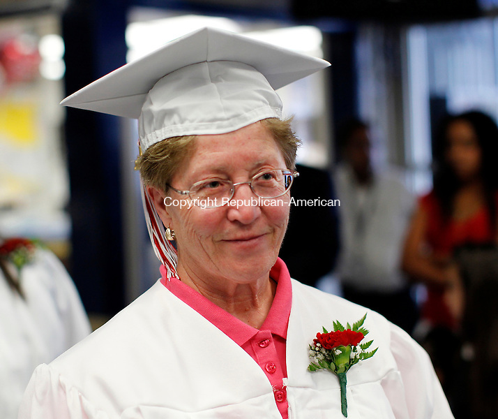 Waterbury, CT-10, June 2010-061010CM07  Gesummina Perugini smiles while walking into Kennedy High School auditorium for the Waterbury Adult Continuing Education graduation.  --Christopher Massa Republican-American
