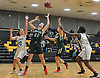 Caroline McLaughlin #22 of Carle Place, second from left, grabs a rebound during a non-league varsity girls basketball game against Mepham at Wantagh High School on Thursday, Dec. 7, 2017. Carle Place won by a score of 54-35.