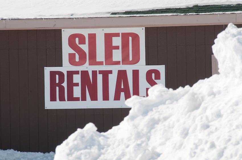 Sign for snowmobile rentals in Calumet Michigan.