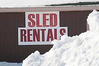 Sign for snowmobile rentals in Calumet Michigan.