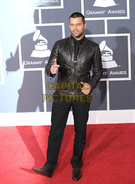 RICKI MARTIN.Arrivals at the 52nd Annual GRAMMY Awards held at The Staples Center in Los Angeles, California, USA..January 31st, 2010.grammys full length black trousers brown leather jacket ricky hand thumb up.CAP/RKE/DVS.©DVS/RockinExposures/Capital Pictures