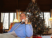United States President George W. Bush talks to members of the military during a round of Christmas Eve phone calls from Camp<br /> David, the Presidential retreat near Thurmont, Maryland, Monday, December 24, 2001. <br /> Mandatory Credit: Eric A. Draper / White House via CNP