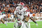 Arkansas Razorbacks defensive tackle Taiwan Johnson (94) in action during the Advocare V100 Texas Bowl game between the Arkansas Razorbacks and the Texas Longhorns at the NRG Stadium in Houston, Texas. Arkansas defeats Texas 31 to 7.
