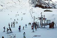 Switzerland. State of Ticino. Airolo. Skiers and ski lifts on the Peschün ski resort. © 2005 Didier Ruef