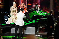 Helen Mirren rides with Mark Bridges as he wins a jet ski for delivering the shortest acceptance speech after winning the Oscar&reg; for Achievement in Costume Design for work on &ldquo;Phantom Thread&rdquo; during the live ABC Telecast of The 90th Oscars&reg; at the Dolby&reg; Theatre in Hollywood, CA on Sunday, March 4, 2018.<br /> *Editorial Use Only*<br /> CAP/PLF/AMPAS<br /> Supplied by Capital Pictures