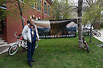 National Geogrpahic photographer Carsten Peter stands in front of his work on China's Super Karst displayed outdoors during the Mountainfilm Festival in Telluride, Colorado on May 24, 2015.