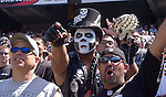 "Trio of Raider fans, Mark Charles of Stockton, ""Dr. Dolamite"" of Oakland, and Pete Anduha of Redwood City, on Sunday, September 14, 2003, in Oakland, California. The Raiders defeated the Bengals 23-20."