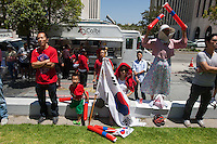 Los Angeles, CA -  Sunday, June 22, 2014: Some of the thousands of Koreans watched the South Korea vs. Algeria first round match on the  front lawn of Wilshire Park Place.
