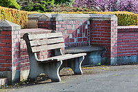 Garden bench adorns circa 1920 plaza.  Dating to 1927, the Masonic Retirement Center, locally known as the Masonic Home, in Des Moines, Washington is now an elegant event center available for rental.  In the historic Zenith neighborhood of the city of Des Moines. Please contact douglasorton@comcast.net regarding licensing of this image.