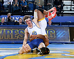 BROOKINGS, SD - JANUARY 18: Luke Zilverberg from South Dakota State University rolls Archie Colgan from Wyoming during their 157 pound match Thursday night at Frost Arena in Brookings. (Photo by Dave Eggen/Inertia)