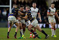 Toronto Wolfpack's Josh McCrone is tackled by Leeds Rhinos' Ash Handley and Cameron Smith<br /> <br /> Photographer Alex Dodd/CameraSport<br /> <br /> Betfred Super League Round 6 - Leeds Rhinos v Toronto Wolfpack - Thursday 5th March 2020 - Headingley - Leeds<br /> <br /> World Copyright © 2020 CameraSport. All rights reserved. 43 Linden Ave. Countesthorpe. Leicester. England. LE8 5PG - Tel: +44 (0) 116 277 4147 - admin@camerasport.com - www.camerasport.com
