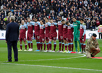 2nd November 2019; London Stadium, London, England; English Premier League Football, West Ham United versus Newcastle United; West Ham United players stand for a minute silence - Strictly Editorial Use Only. No use with unauthorized audio, video, data, fixture lists, club/league logos or 'live' services. Online in-match use limited to 120 images, no video emulation. No use in betting, games or single club/league/player publications