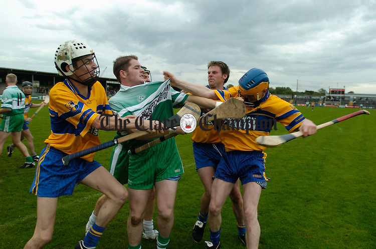 The lads from Sixmilebridge and Wolfe Tones get heated during their game in Cusack park. Photograph by John Kelly.
